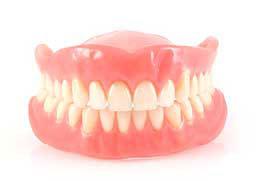 Prótese fixa, prótese móvel ou implante dentário.